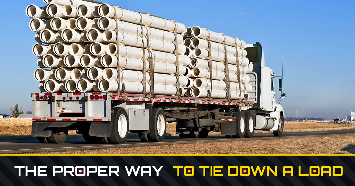 Proper way to tie down a load, showing a semi truck hauling large PVC pipe tied down with tie down straps.